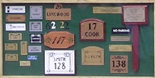 picture of wooden house signs and nameplates, brass nameplates, engraved nameplates