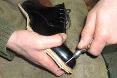 sole being replaced on a shoe